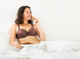 woman eating sweet chocolate chip cookies
