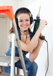 sexy  girl in headphones with drill