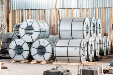 Bended steel/metal sheet rolls in factory warehouse/workshop.