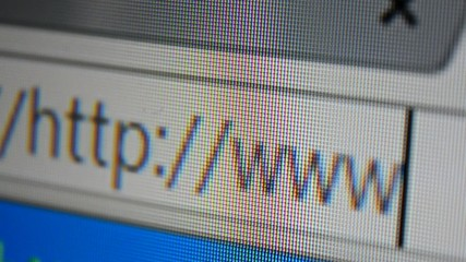 Close up of mouse cursor typing in web browser address bar