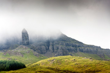 Green landscape of Scotland. Behind the Old man of Storr