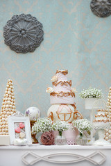Elegant sweet table with big cake on wedding party
