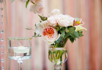 Flowers bouquet and candle as decoration