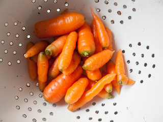 close up of washed carrots in a collander