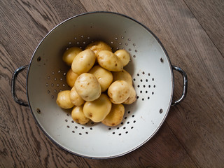 washed  new potatoes in a collander