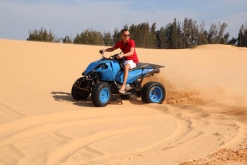 man on ATV in desert