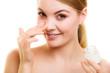 Skin care. Girl applying moisturizing cream.