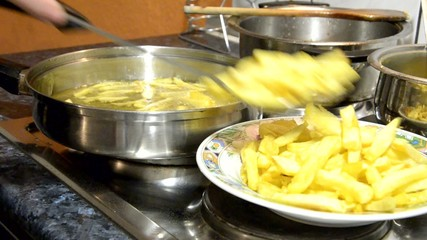 French Fries boiling in oil.