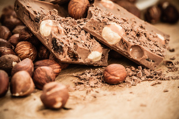 chocolate shavings and pieces on wooden table