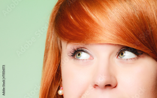canvas print picture Redhair girl thoughtful woman thinking looking up,