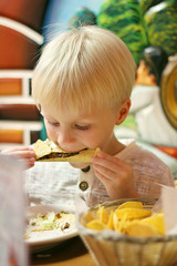 Young Child Eating Taco at Mexican Restaurant