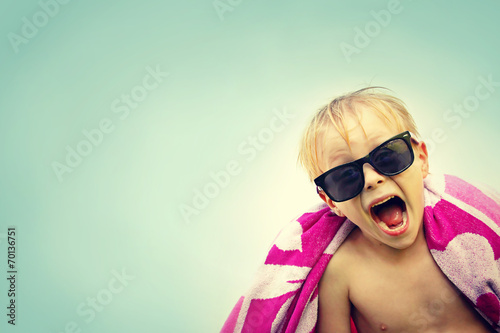 Excited Child in Beach Towel on Summer Day - 70136751