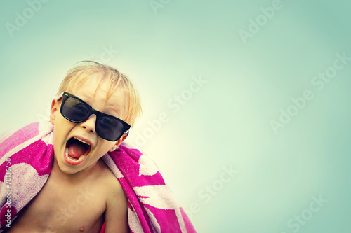 Excited Child in Beach Towel on Summer Day - 70136758
