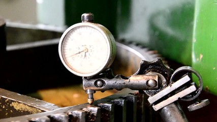 dial gauge instrument measures inclination of cogwheel gear