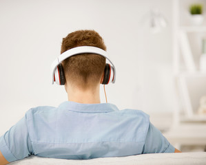 Man listening music with headphone
