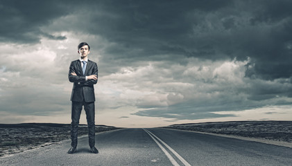 Businessman on road