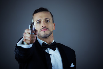 Handsome young man holding a gun