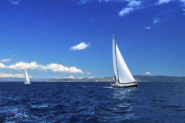 Sailing on luxury yachts in the waters of the Aegean Sea.