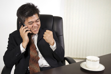 Businessman feeling happy at work