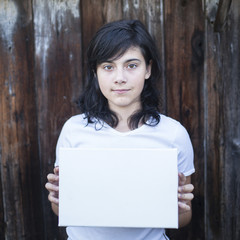 Teen girl with a white sheet in his hands.
