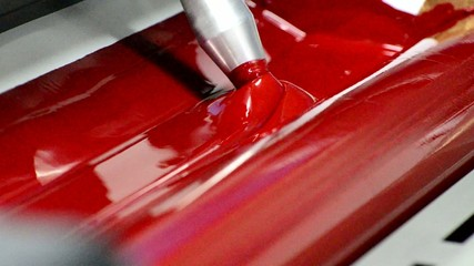Red on the offset  print press machine closeup