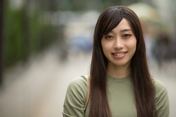 Young Asian woman in city