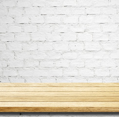 Empty wooden table over white brick wall, template.