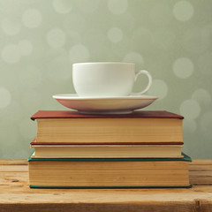 Coffee cup on old books