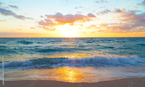 Fotobehang Strand Sunrise over the ocean in Miami Beach, Florida.