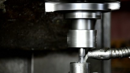 Industrial CNC machine milling some steel part