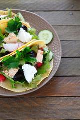 nourishing pita with fish and salad