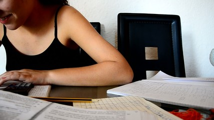 Student Smiling and doing homework
