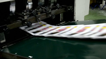finished brochure magazine goes on the packaging line