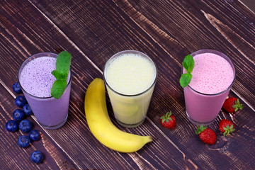Strawberry, banana and blueberries milkshakes