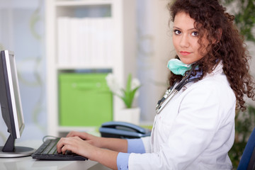 Beautiful female doctor working in office