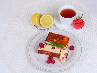 Cheese casserole with raisins and mint on white napkin