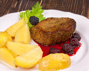 Grilled beef steak with blackberry sauce and potato