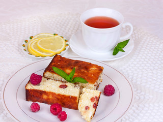 Cheese casserole with raisins and mint on plate oт white napkin