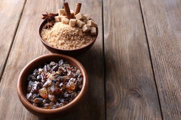 Brown sugar cubes, reed and crystal sugar in bowls