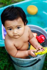 Cute baby girl bathing