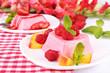 Cakes with fruit and berries on plate on napkin