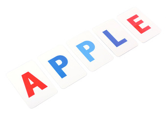 Apple word formed by educational paper cards isolated on white