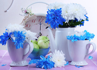 Composition of white and blue chrysanthemum and utensil