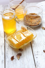 Fresh honey on wooden table