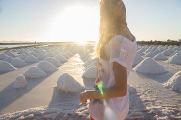 Woman enjoying sunset at salt marsh