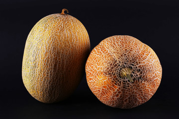 Melons isolated on black