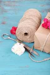 Beautiful gift with flowers and decorative rope,
