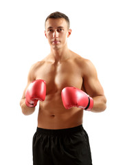 Handsome young muscular sportsman with boxing gloves isolated