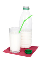 Bottle and glass of milk with green drinking straw on red napkin
