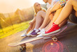 canvas print picture - Young peoples legs with skateboard